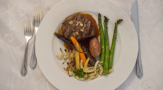 plated filet steak with asparagus and carrots