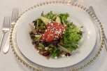 plated pear salad on bed of leafy greens