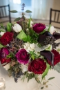 red and fuscia roses, dark purple calla lilies with white tulips and hydrangea