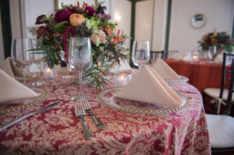 red paisley linens with english garden centerpiece