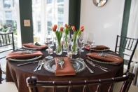 Chivari Chairs with Earth tone linens and tulips