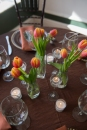 tulips, tea lights on earth tone linens