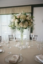 tall centerpiece with neutral table linens