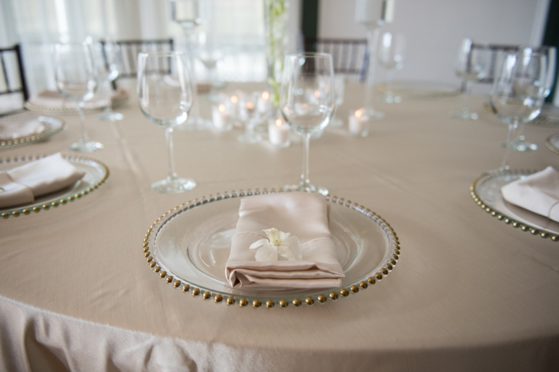 soft neutral place setting with gold rimmed dishes