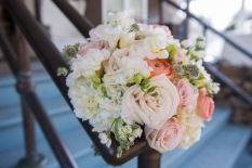 pastel rose bouquet decorating banister