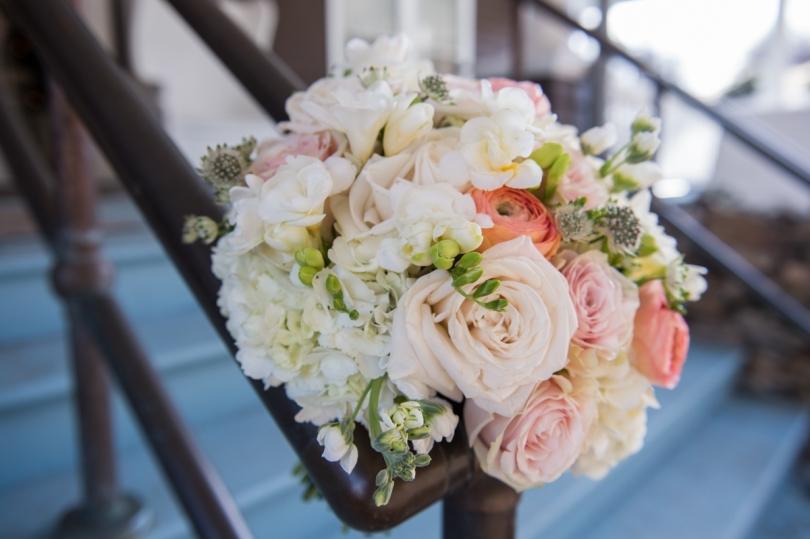 pastel rose bouquet decorating banister
