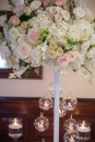 high based floral arrangement with hanging tealights