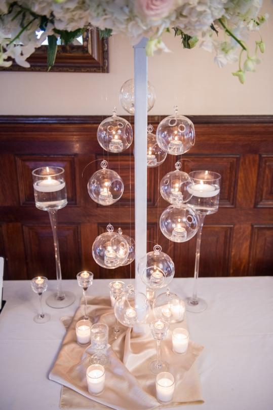 high based floral arrangement with hanging tealights