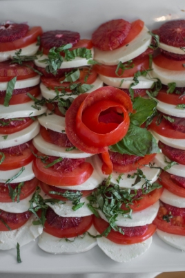 tray of mozzarella and tomato with basil