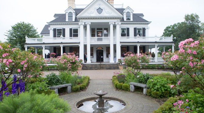 lounsbury house with gardens and fountain in front