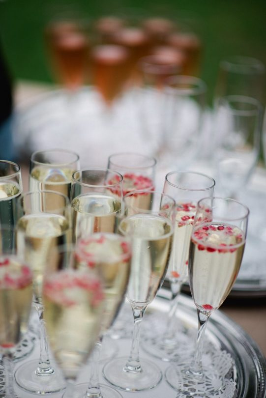 champagne glassed filled with pomegranite seeds for accent