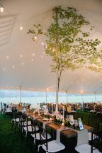 tables set up under tent with tree for decoration