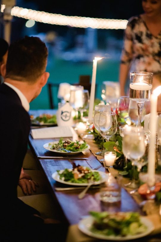 guests seated for the table with salad