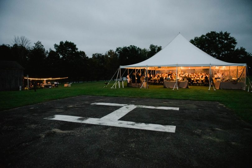 tent reception next to the helicopter landing pad